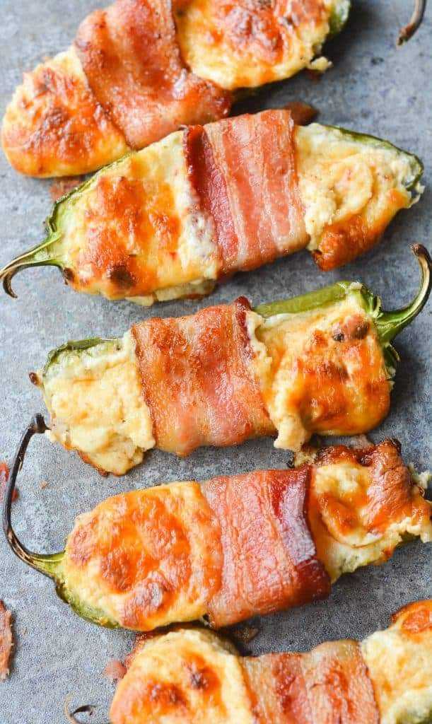 These Bacon Wrapped BBQ Jalapeno Poppers are an incredibly savory, flavorful low carb dish. Perfect to bring to any backyard BBQ, or to just enjoy at home!