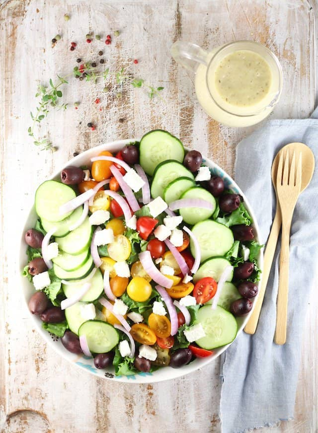 Greek Salad with Roasted Garlic Salad Dressing is a flavor packed salad that can be served as a side or main dish for any night of the week!