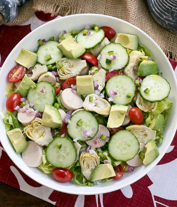"""This Hearts of Palm, Artichoke, Avocado and Butter Lettuce Salad is not light on flavor, but would be the perfect dish to """"Lighten Up Your Holiday Table,"""" our Sunday Supper theme."""
