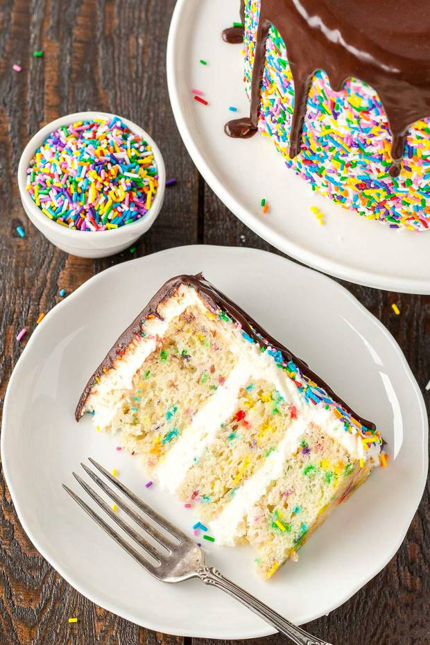 his Sprinkle Studded Funfetti Cake is paired with a fluffy cream cheese frosting and topped with a rich dark chocolate ganache.
