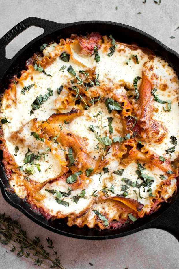 This vegetarian caprese skillet lasagna recipe is a delicious lighter take on lasagna. It's really easy and all cooked right in the skillet!