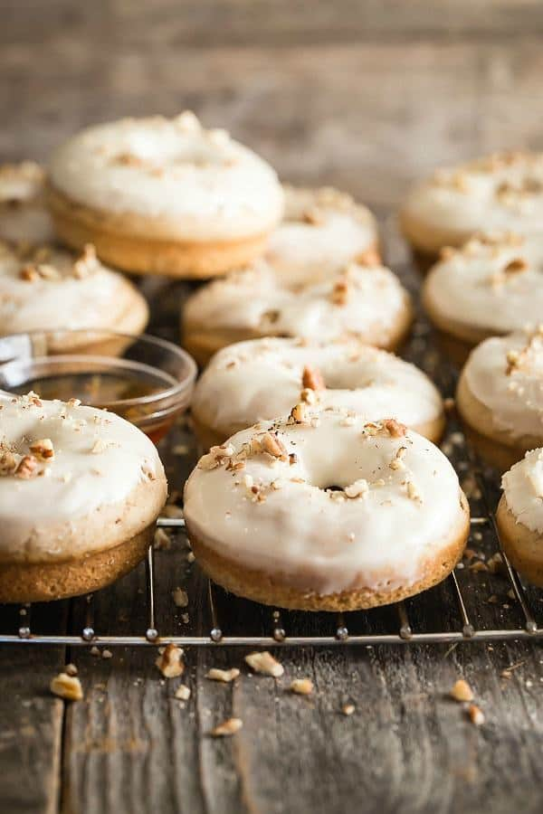 Maple Pecan Baked Donuts are to die for!The frosting needs its own podium. Powdered sugar is mixed with vanilla, milk and maple syrup.