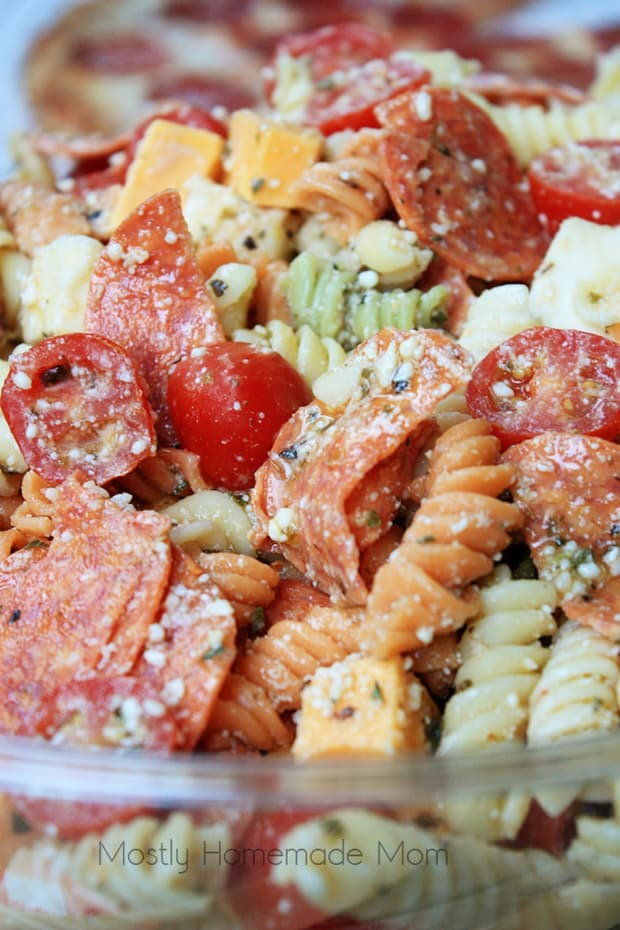 ThisPepperoni Pizza Pasta Saladfeatures tri colored rotini pasta with pepperoni, mozzarella, cheddar, and tomatoes in a Parmesan vinaigrette. ThisItalian pasta saladvariation is the perfect summer side dish recipe!