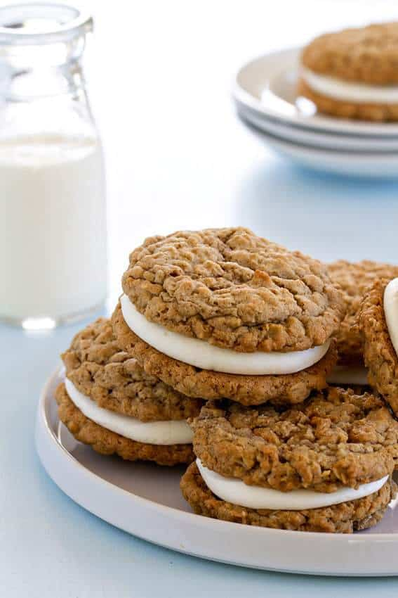 Soft and chewy oatmeal cookies are sandwiched together with delicious vanilla buttercream to create the perfect dessert. Forget Little Debbie, fresh, homemade Oatmeal Cream Pies are where it's at.