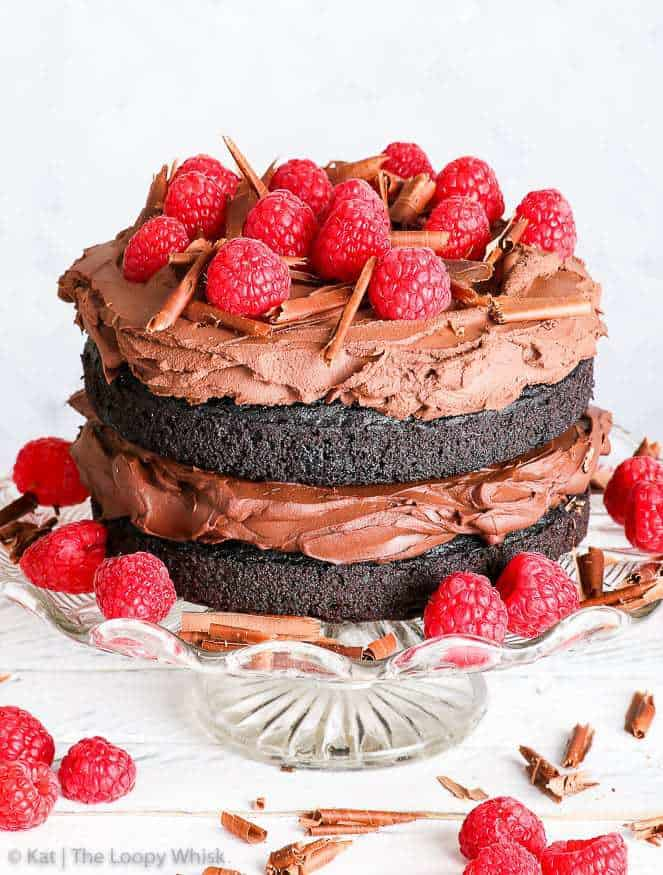 This gluten free vegan chocolate cake will blow you away – with how it looks, how it tastes and how incredibly easy it is to prepare. No fuss, no weird fancy ingredients, only an hour of your time… and you've got yourself a decadent, gorgeous gluten free vegan cake. And the best thing: nobody could possibly guess that it contains no gluten, no eggs, no butter and no milk. Yes, it's that good.