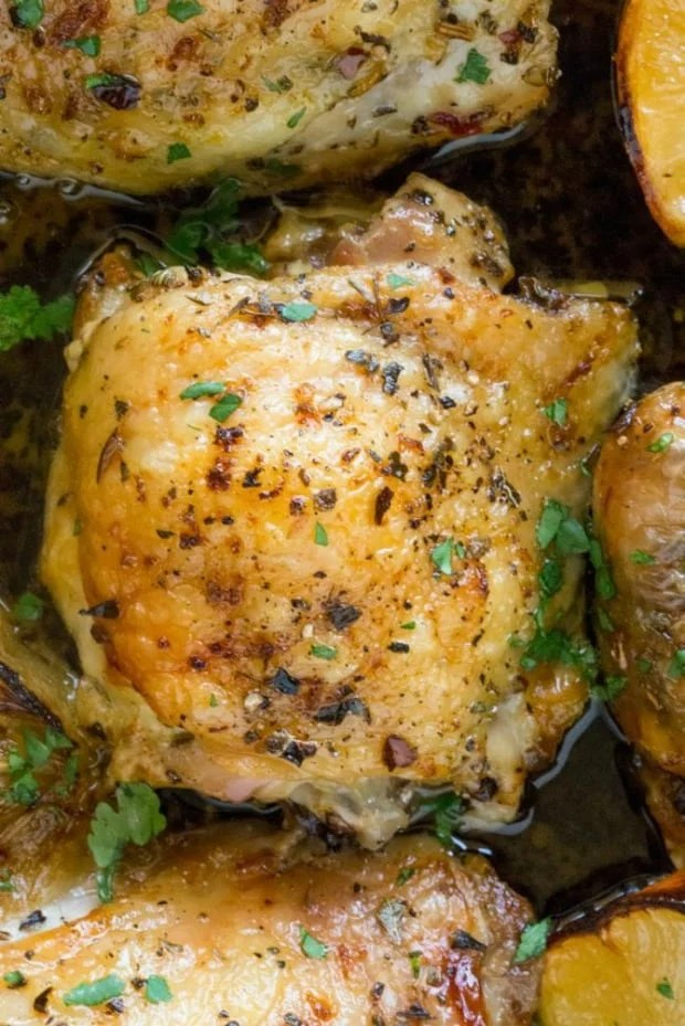Easy Greek Lemon Chicken is made with just a handful of ingredients in a cast iron skillet along with roasted lemon wedges that make an easy pan sauce