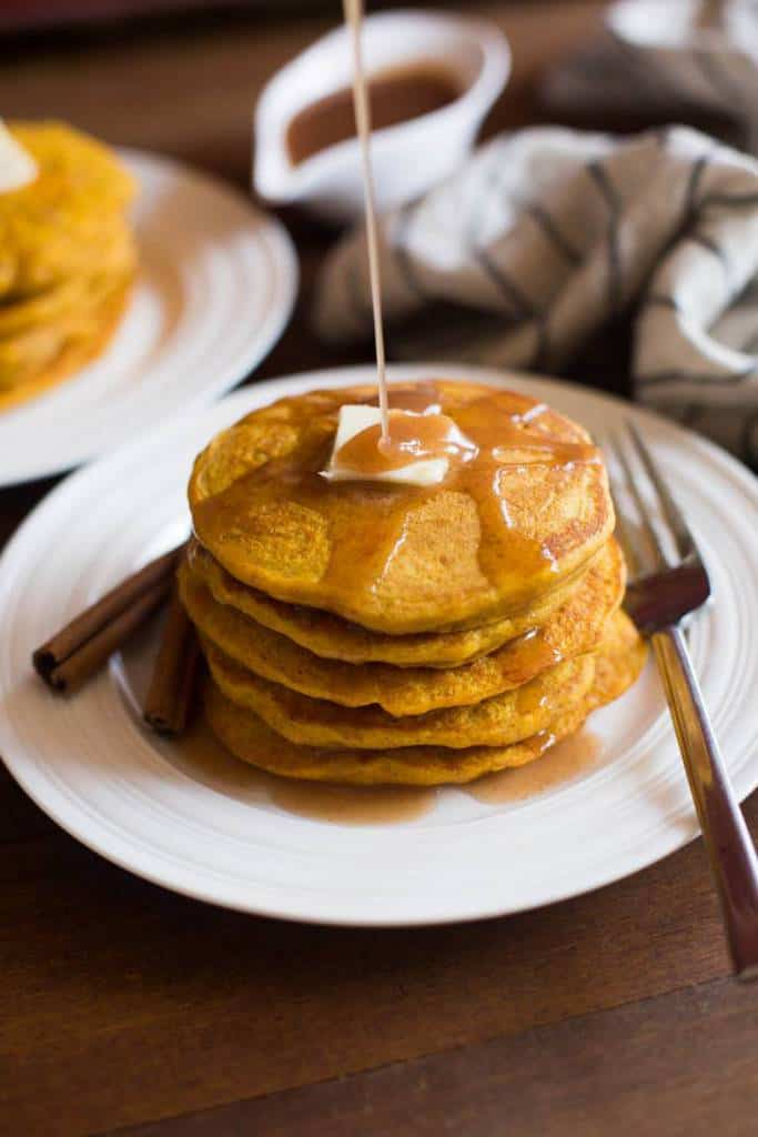 Light and fluffy pumpkin pancakes with a deliciously sweet cinnamon syrup.