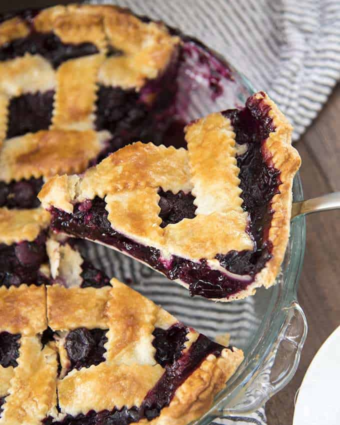 Blueberry Pie with the best flakey and buttery homemade crust and a delicious, lightly sweetened blueberry filling - perfect served warm with a big scoop of vanilla ice cream!