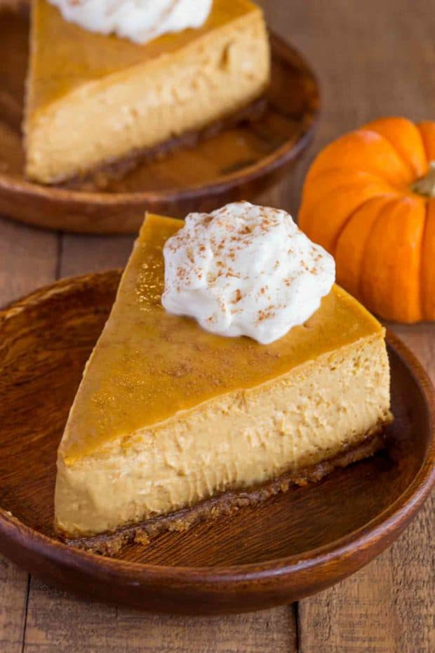 Pumpkin Cheesecake with a Gingersnap crust is a classic holiday dessert that is creamy and rich with fresh pumpkin and homemade pumpkin spice flavors.