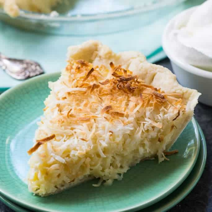 Coconut Macaroon Pie has a luscious custard filling with oodles of shredded coconut. The coconut on top gets a little bit browned and chewy and is such a wonderful contrast to the super sweetness of the custard.
