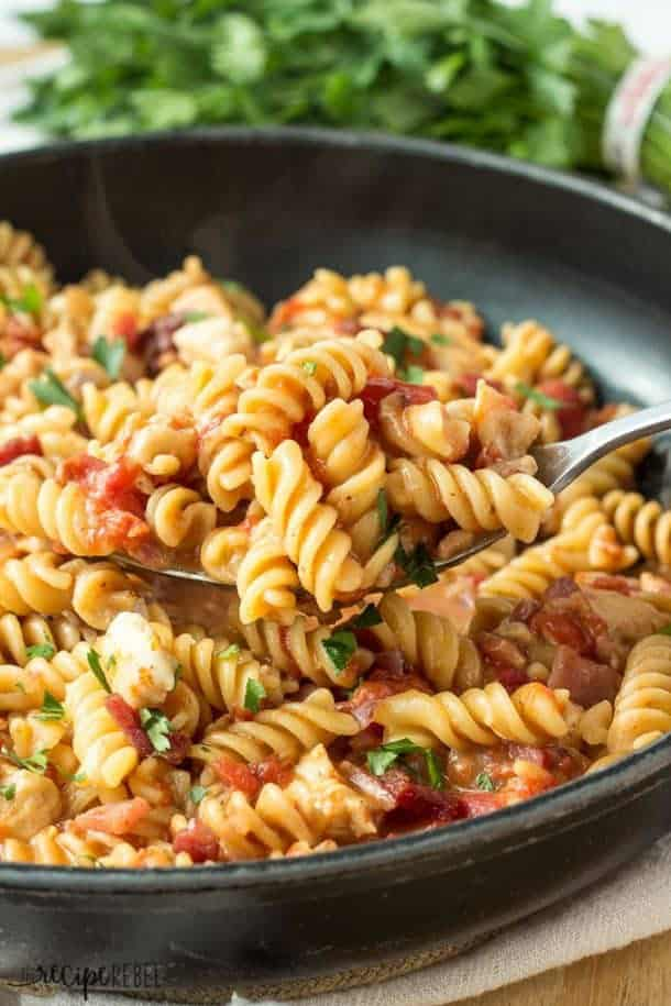 This One Pot BBQ Chicken Pasta with Bacon is SO easy and so good — hearty, cheesy and a little smoky from barbecue sauce. Includes step by step recipe video.