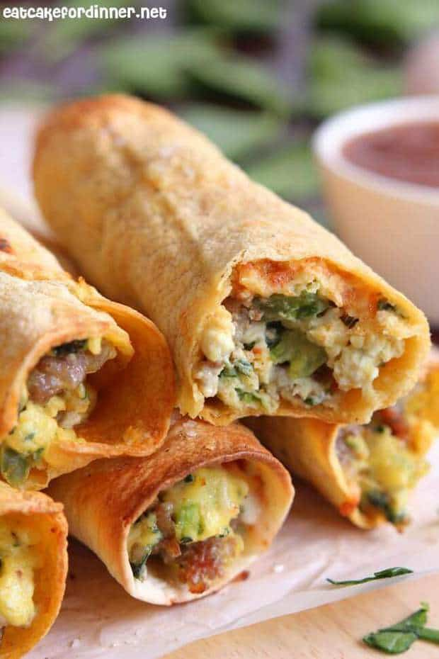 Make the PERFECT breakfast recipe! These taquitos are filled with all of your favorite breakfast ingredients before they get baked to perfection in the oven. Trust us, once you try a taquito baked you'll never go back to frying them again.