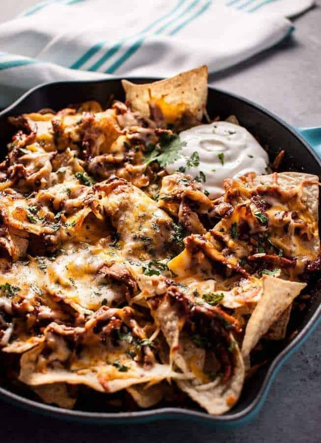 BBQ chicken skillet nachos are fast, easy, and delicious! The perfect game-day comfort food appetizer. Ready in only 25 minutes!