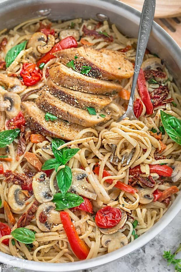 This One Pot Tuscan Chicken Pasta is loaded with flavor and makes the perfect easy 30 minute weeknight meal. Best of all, everything cooks in just one pan making clean up a breeze!