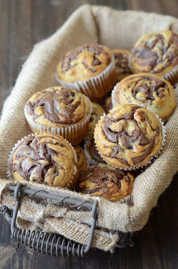 hese Nutella Banana Swirl Muffinsare one of my absolute favorite ways to use up overripe bananas. Obviously they are tasty (hello, banana + Nutella = match made in heaven), but they also can be whipped up in under 30 minutes from start to finish. Total win-win in my book.