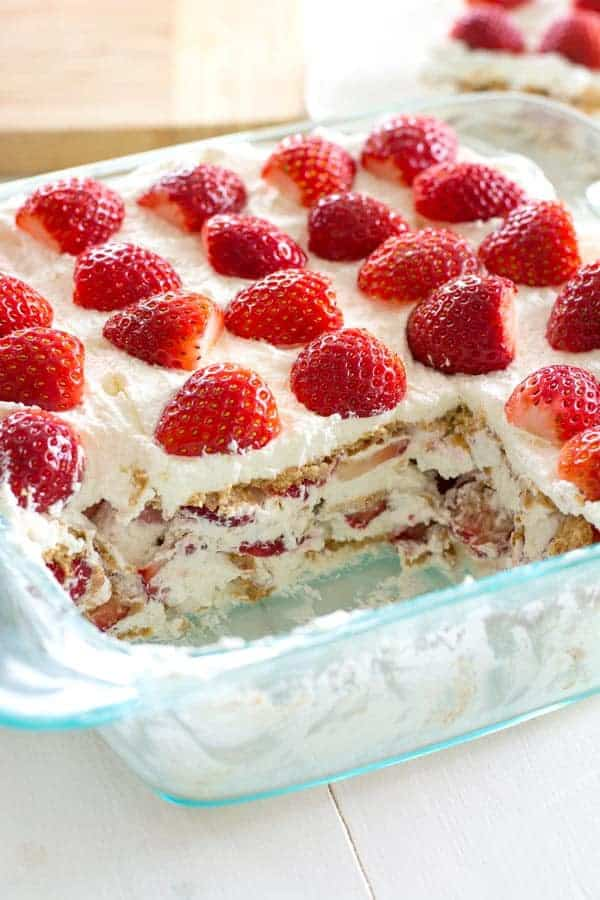 Take fresh strawberries and cream to the next level with this no-bake Strawberry Shortcake Icebox Cake. Fluffy whipped cream, juicy strawberries and graham crackers are all you need to make this potluck favorite!