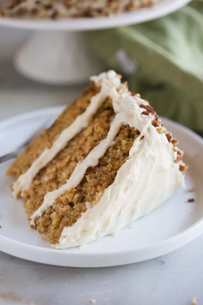 There's a reason I've called this the The Ultimate Carrot Cake with cream cheese frosting: it's extra moist and tender and flavored with the perfect blend of spices. It's then topped with a smooth and creamy whipped cream cheese frosting. The end result is, dare I say it, the BEST homemade carrot cake you've ever had!