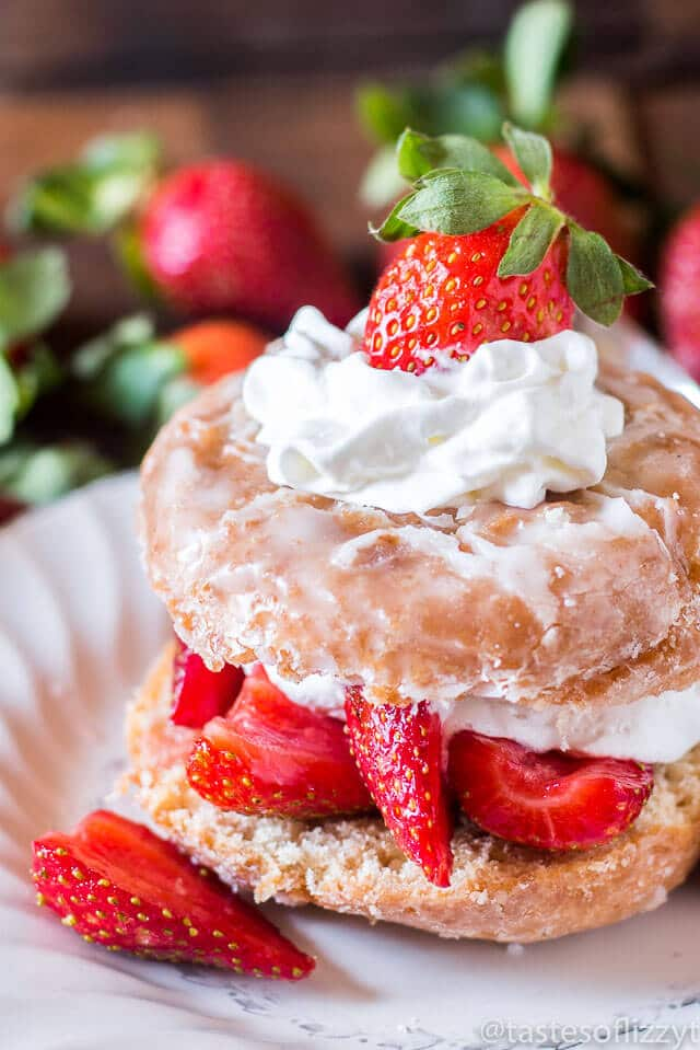 Breakfast and dessert heavens collide with this Donut Strawberry Shortcake. Strawberries in syrup top a sliced donut, soaking in to make the easiest shortcake ev