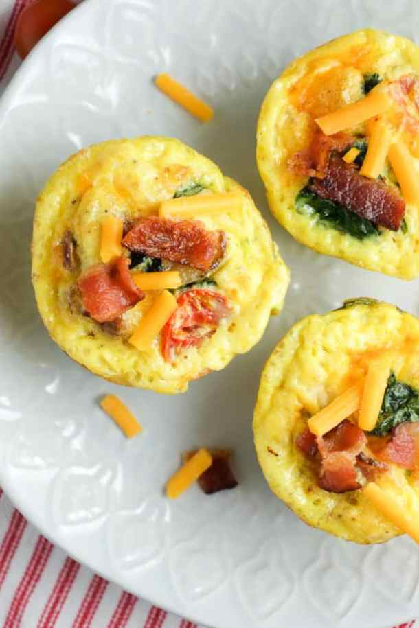 Bacon Spinach Egg Tomato Breakfast Cups -- part of Cheesy Breakfast Recipes PERFECT for Saturday Mornings