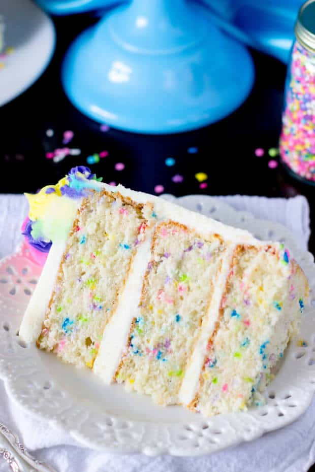 A light and fluffy, made from scratch funfetti cake (sometimes also called confetti cake)! This soft, snow-white cake is speckled with brightly colored sprinkles and iced with a sweet buttercream frosting — it's the perfect homemade birthday cake!