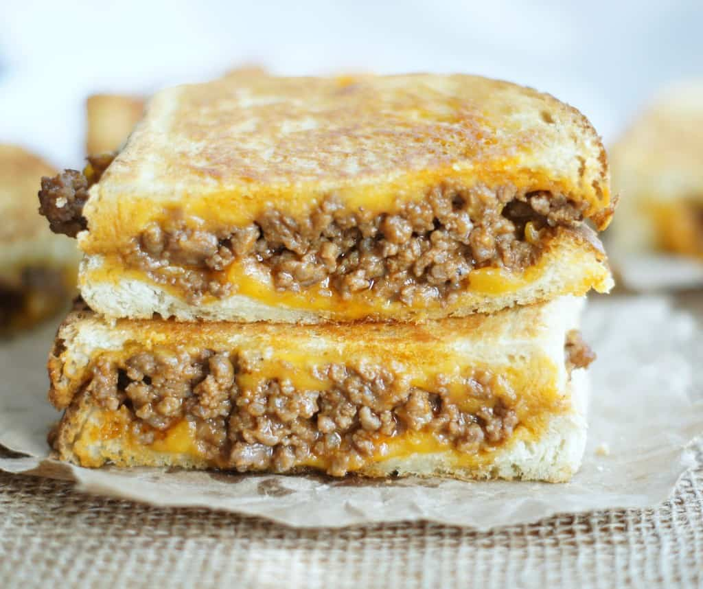 These Sloppy Joe Grilled Cheese Sandwiches are easy to make. Ready in no time at all, their cheesy goodness are a favorite that your kids and family will love!