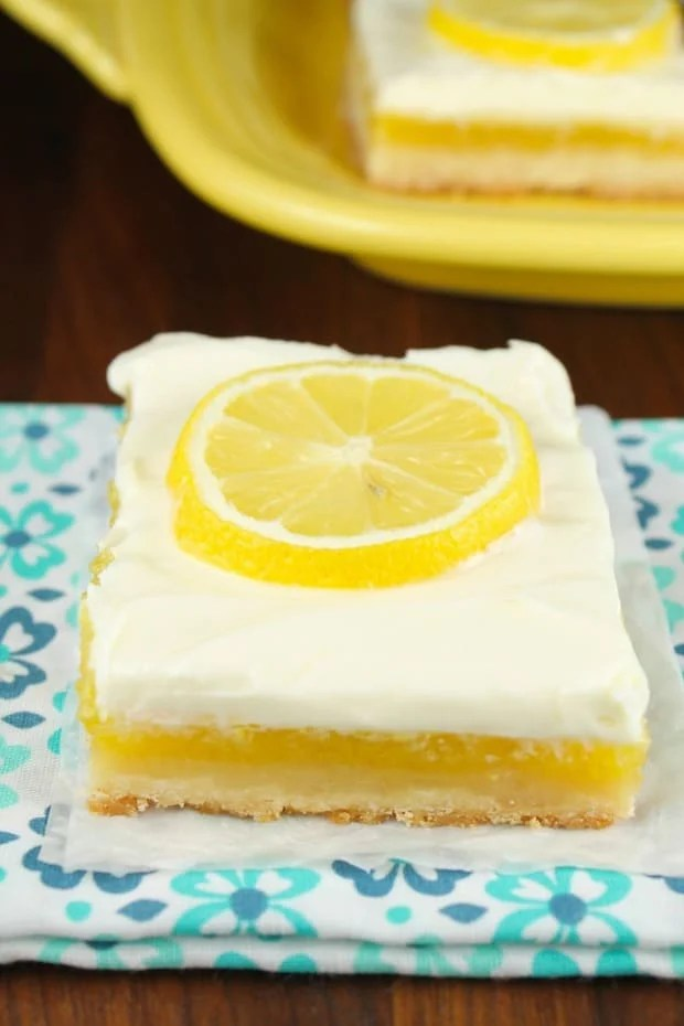 Lemon Bars with Cream Cheese Icing will be the most requested dessert for all of your summer cookouts and parties!