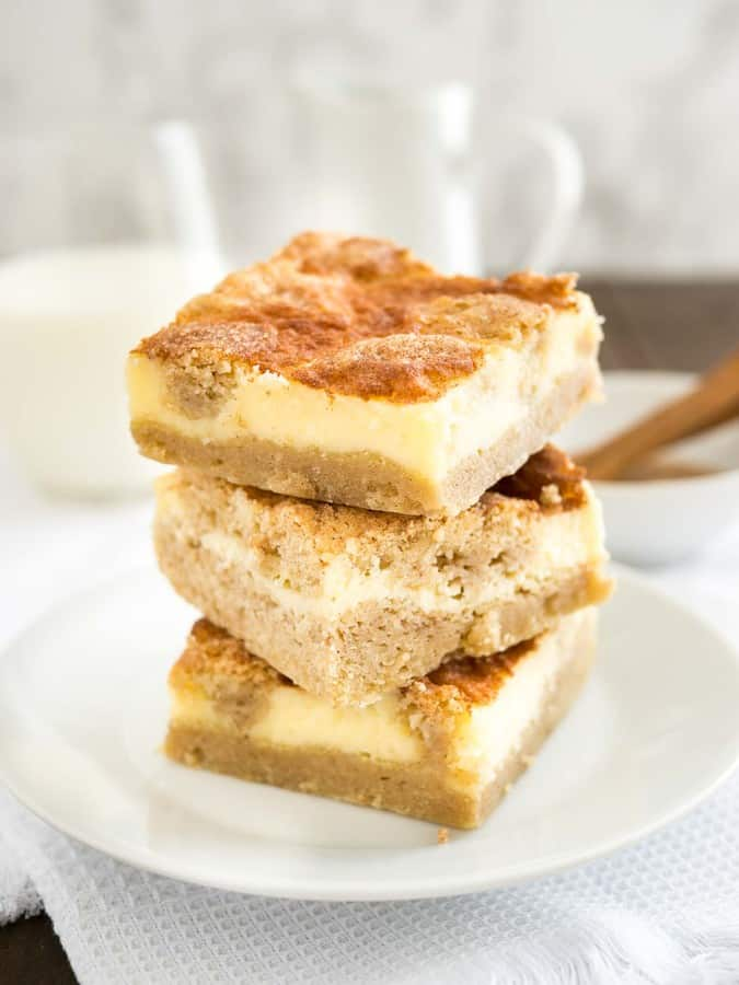 Snickerdoodle Cheesecake Bars are the best of both worlds with a creamy cheesecake top and a soft cinnamon-sugary snickerdoodle bottom.