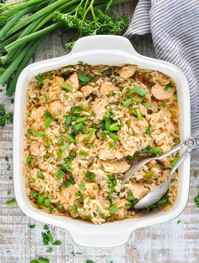 Add a bit of Cajun spice to your next weeknight dinner with this easy Dump-and-Bake Chicken and Dirty Rice! The chicken, rice, and vegetables all cook together in one dish for a quick meal with just 10 minutes of prep!