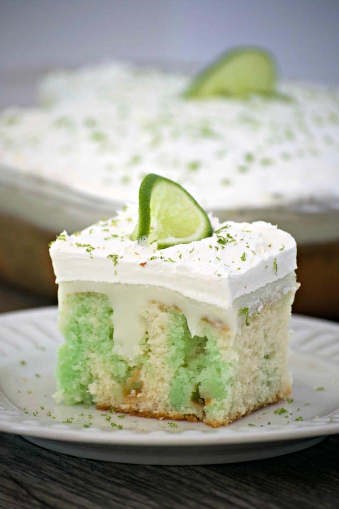 This Key Lime Creme Poke Cake is the perfect dessert to finish off your Cinco De Mayo party! It's so easy to put together and is full of lime flavor.