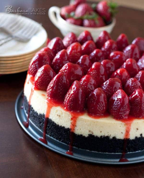 Luscious, creamy New York style cheesecake with a crumbly Oreo cookie crust and topped with fresh strawberries drizzled with a strawberry glaze. This Strawberry Cheesecake with Oreo Crust is bound to be a hit!