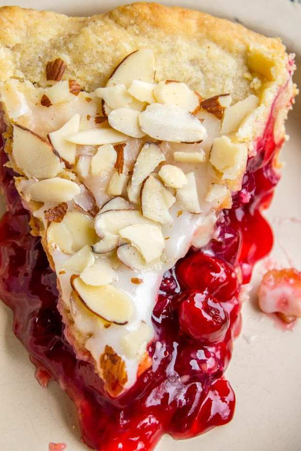 This Cranberry Cherry Pie is just what you need for Thanksgiving! It's has perfect pops of tart from of the cranberries. The almond glaze on the top adds the perfect crunch!