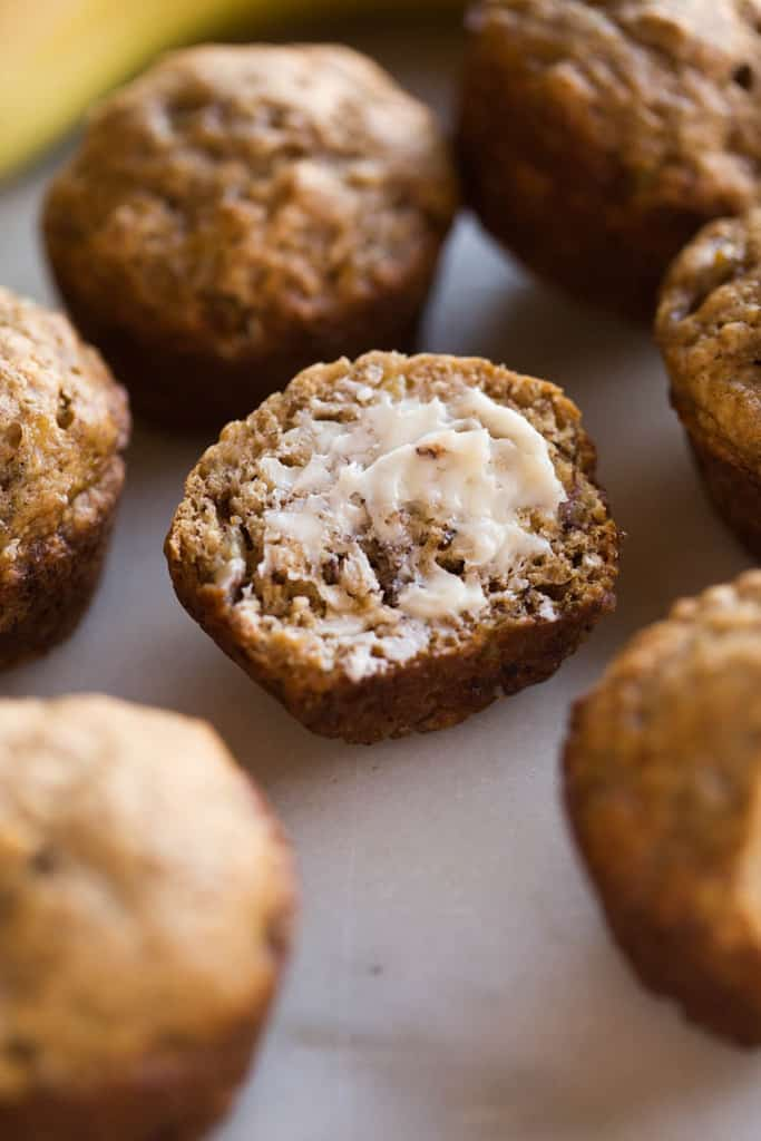 SKINNY BANANA BREAD MUFFINS that are so flavorful and moist you would never know they are healthy (er). These banana muffins have no oil, are low sugar, and just over 100 calories each