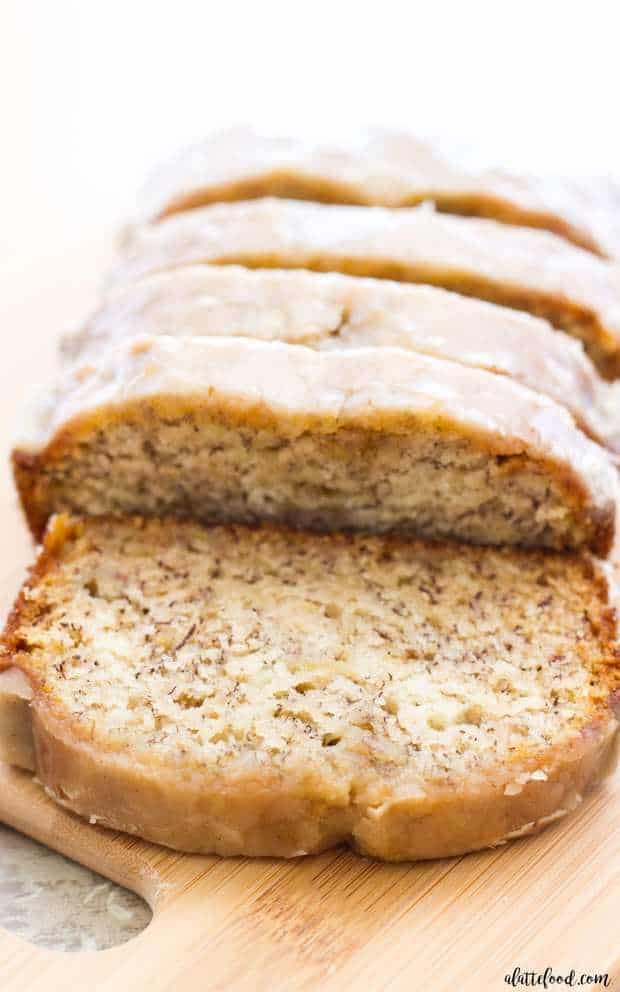 This maple glazed banana bread is an updated take on the classic banana bread recipe! This recipe begins with my mom's banana bread recipe, and ends with a sweet maple glaze that is out of this world delicious! Your life may never be the same again.
