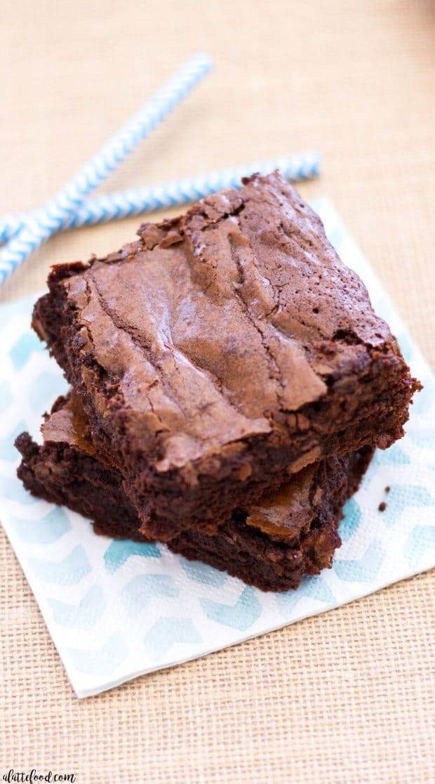Double Chocolate Fudge Brownies are so simple to make! This easy fudge brownie recipe yields thick, rich, and fudgy brownies that are practically swoon-worthy! My favorite homemade brownie recipe ever!