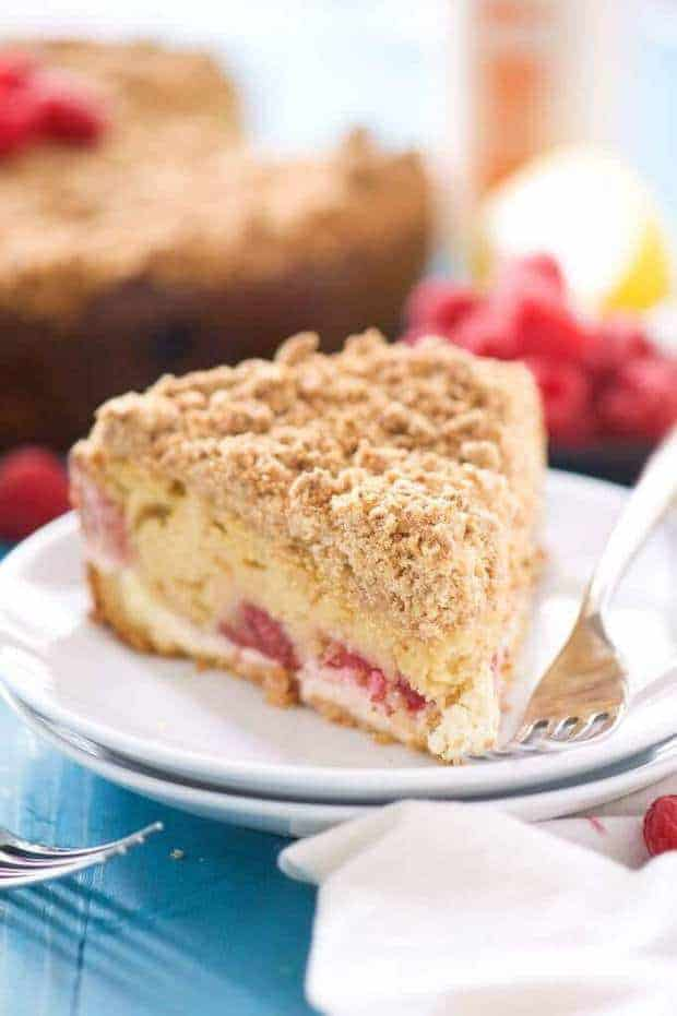 ThisLemon Berry Cream Cheese Coffee CakefromWith Salt and Witis the answer to your brunch prayers! A lightened up coffee cake that is bursting with spring flavors, filled with a creamy cream cheese swirl and a thick crumb layer. A dream come true!