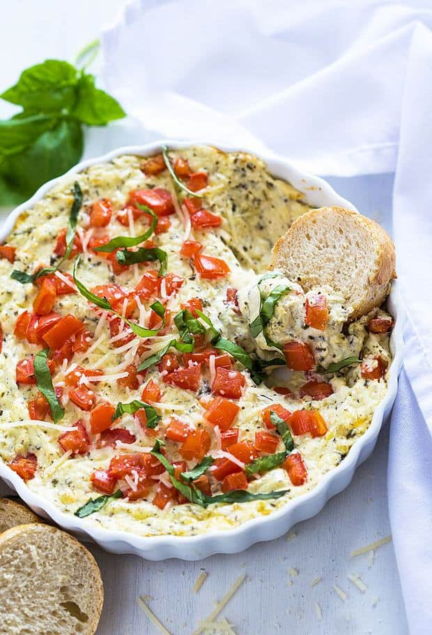 Attention all caprese lovers! You're going to absolutely LOVE this Hot Cheesy Caprese Dip!