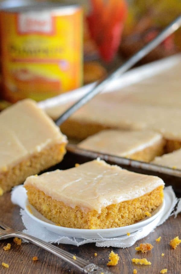 This easy homemade spiced pumpkin cake, is made in a sheet pan, in just 30 minutes and frosted with a creamy cinnamon cream cheese icing!