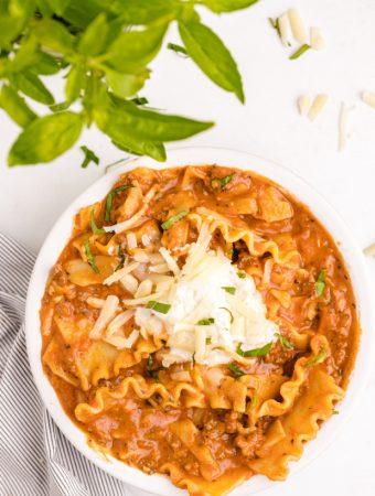 lasagna soup garnish with Mozzarella cheese shredded Parmesan cheese shredded Ricotta cheese Fresh Basil chopped