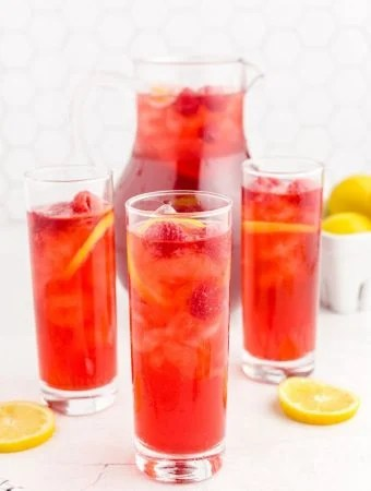 Raspberry Iced Tea in cups and pitcher