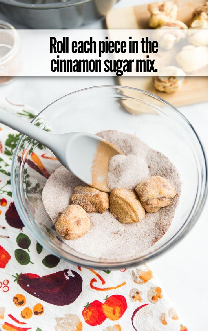 cinnamon roll quarters rolled in cinnamon sugar mix