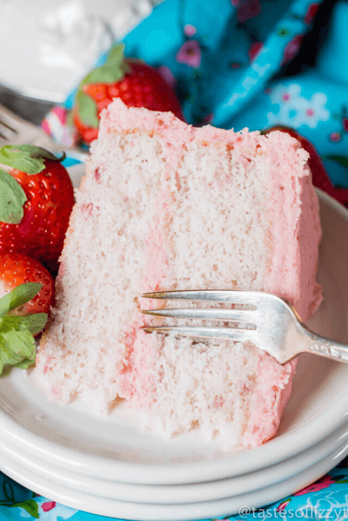 Looking for a homemade strawberry cake? This is it! This from scratch strawberry cake has a tender crumb with melt in your mouth strawberry buttercream.