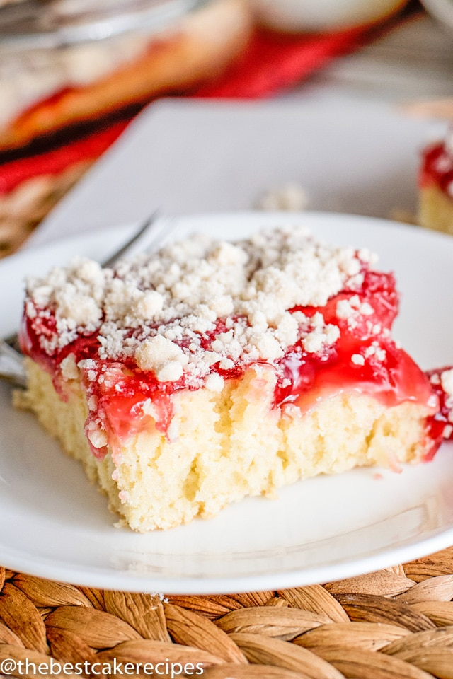 Cherry Coffee Cake - Homemade cake batter uses cherry pie filling for a quick and easy Cherry Coffee Cake that makes a delicious breakfast or dessert. Save part of the crust mixture to sprinkle on top for a yummy sugar streusel.