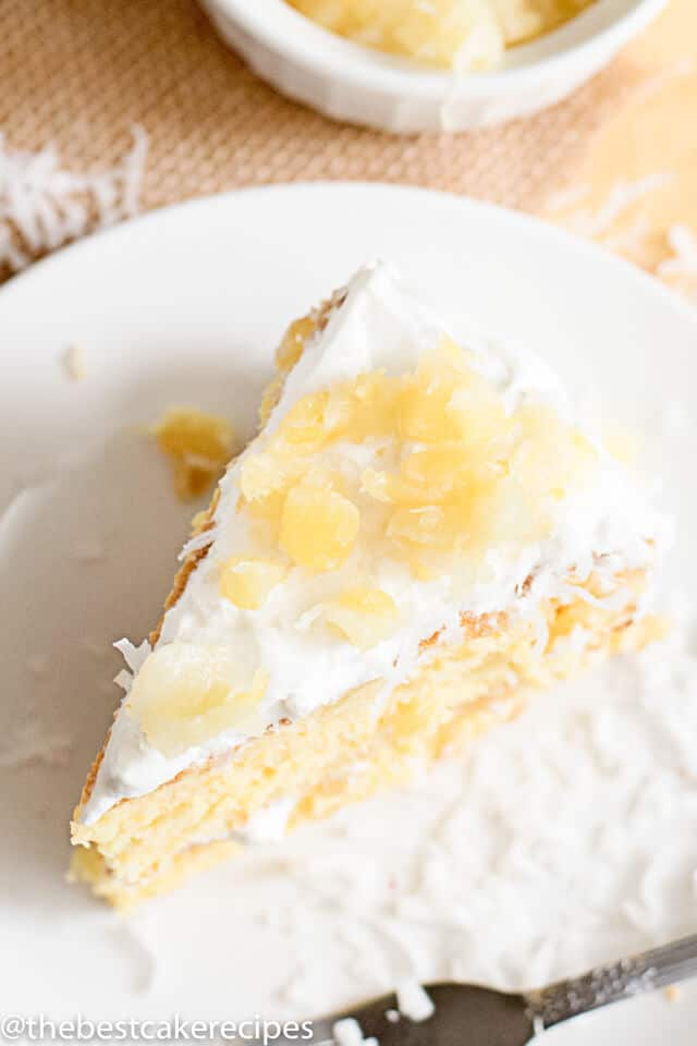 a slice of pineapple coconut cake on a plate
