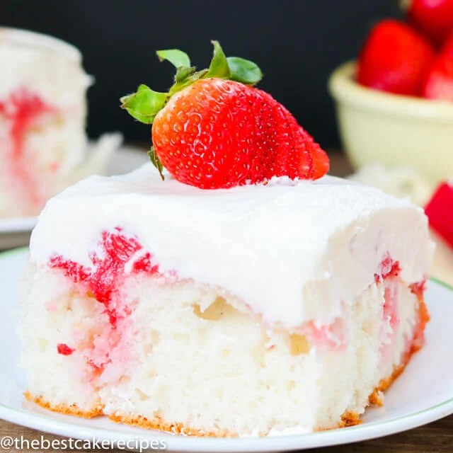 strawberry poke cake on a plate