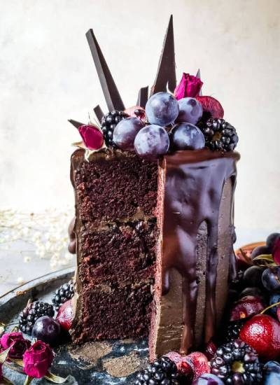 A piece of chocolate cake on a plate, with Blackberries