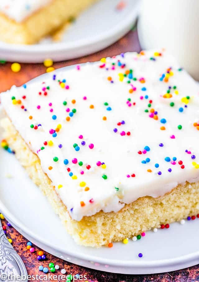 white cake with frosting and sprinkles