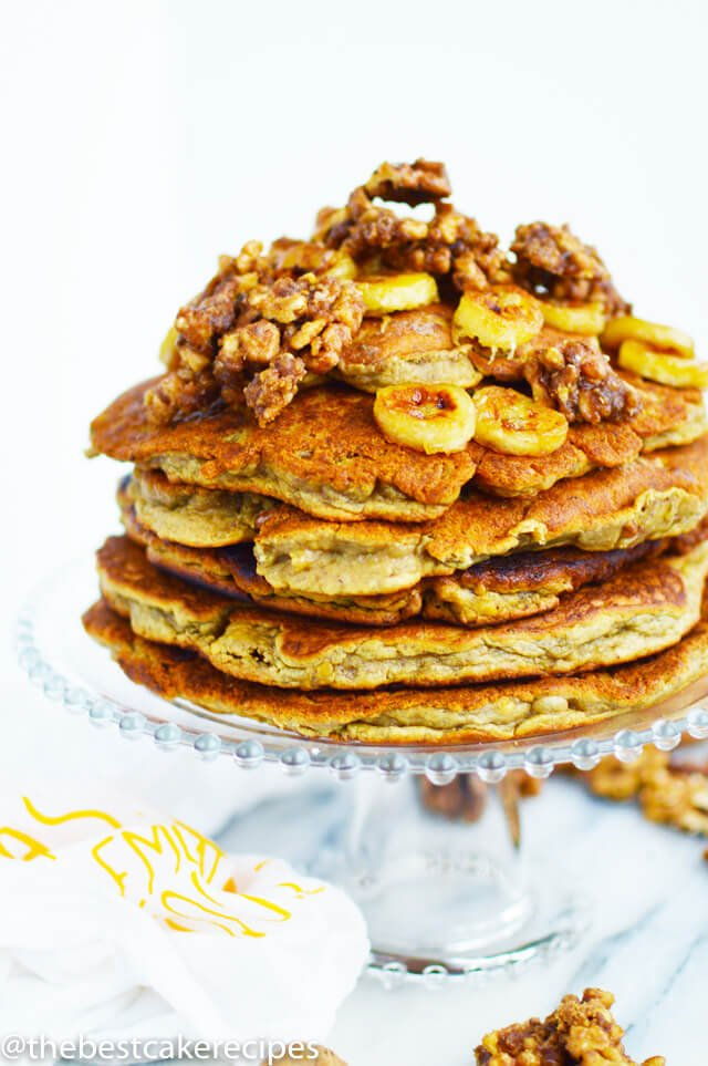stack of pancakes with bananas and nuts