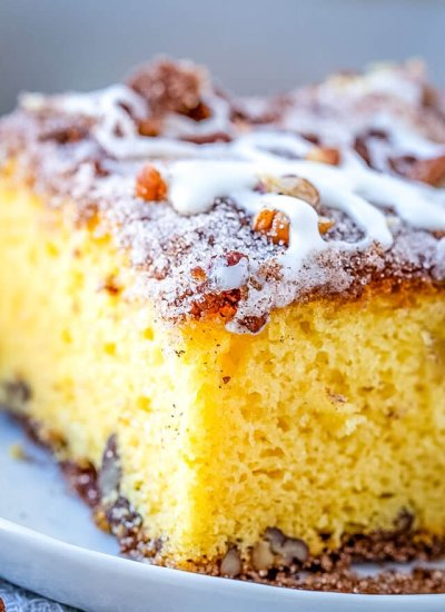 close up of fluffy yellow coffee cake with streusel