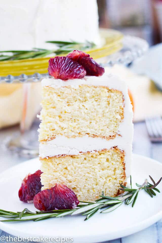 A piece of cake on a plate, with white frosting