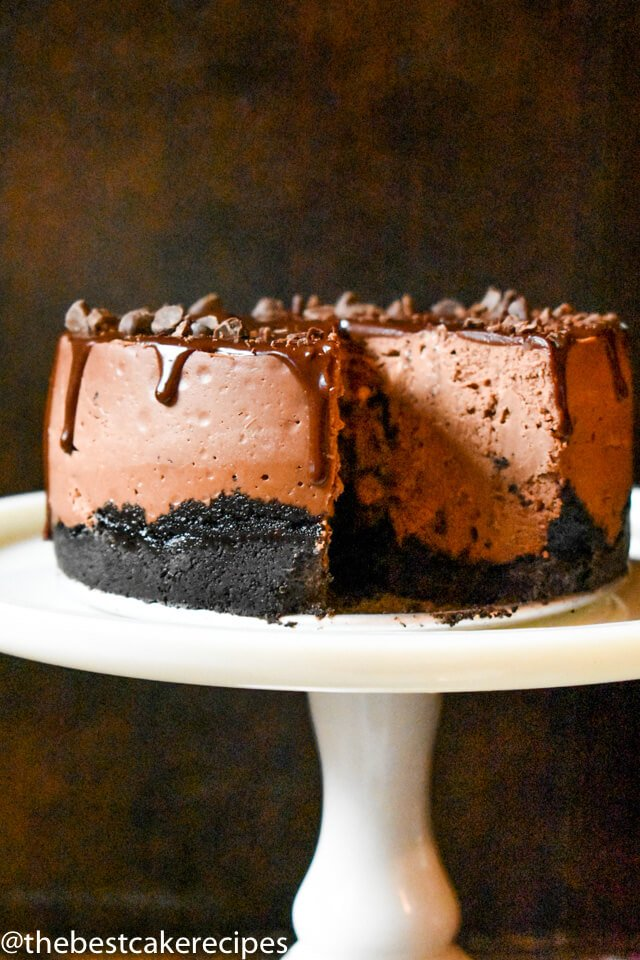 chocolate cheesecake with oreo crust on a cake plate